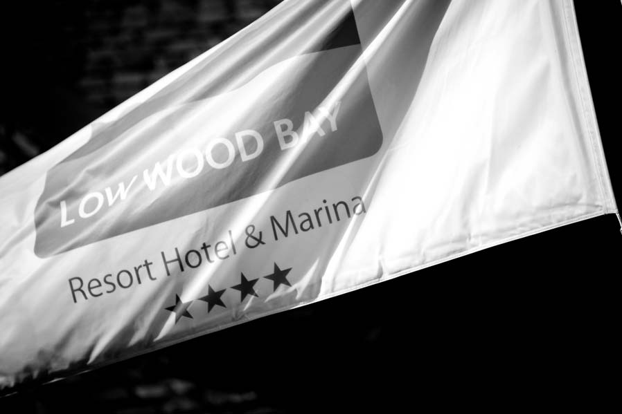 A flag displaying the logo of the Low Wood Bay hotel.