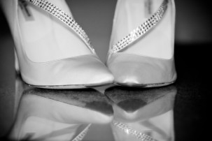 A photograph of wedding shoes in black and white.