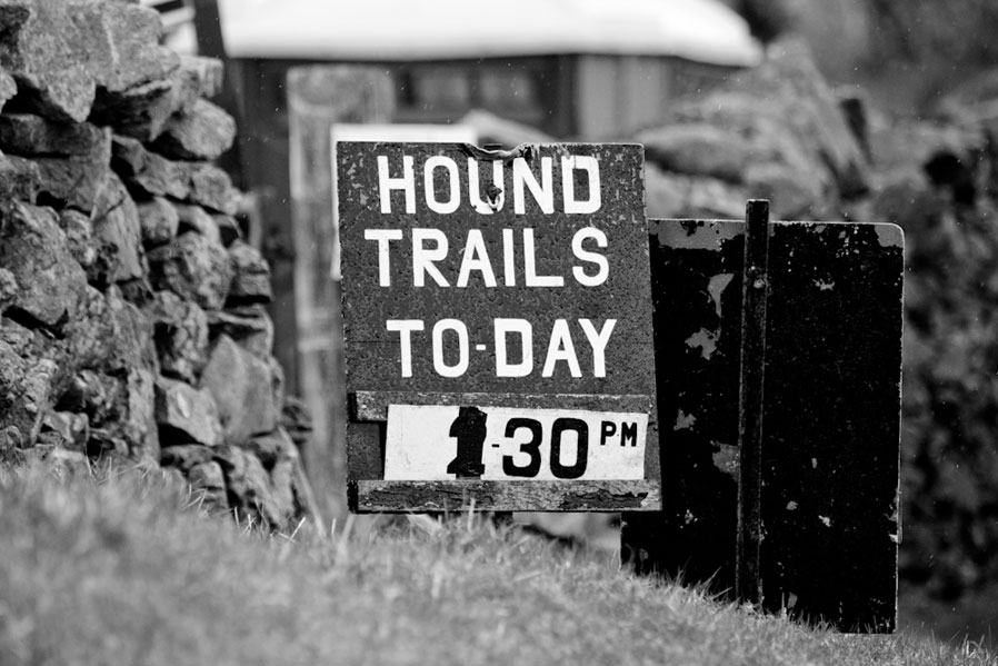 A sign advertising a Hound trail event