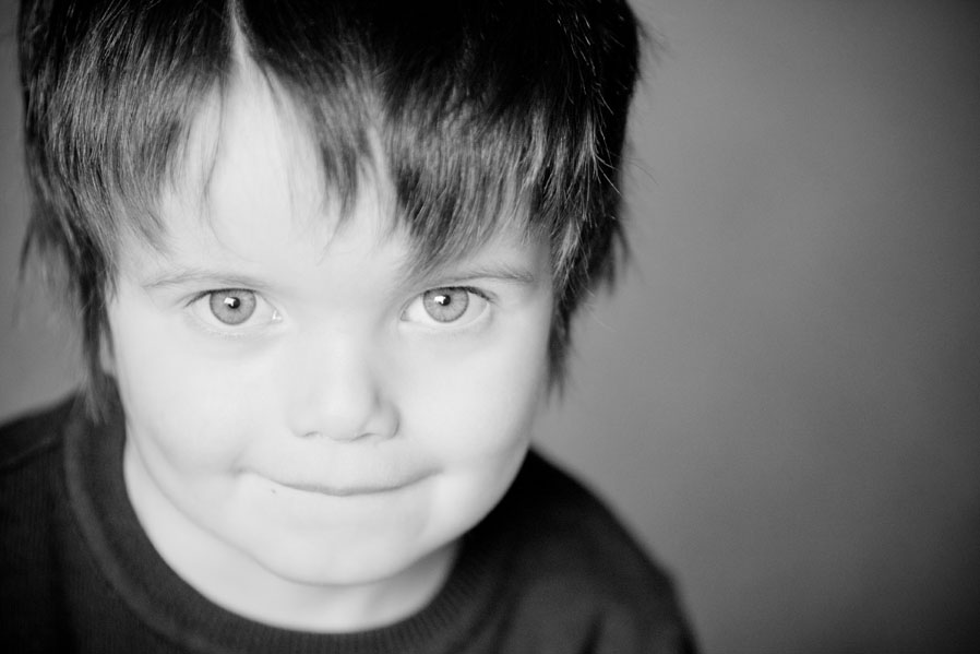 Black and white image of a little boy.