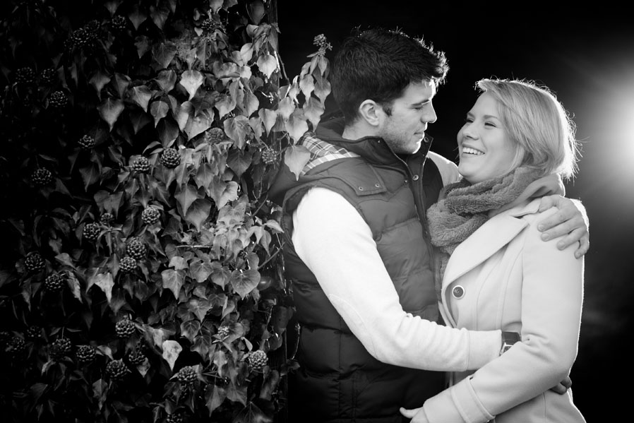 A black and white image of an engaged couple.