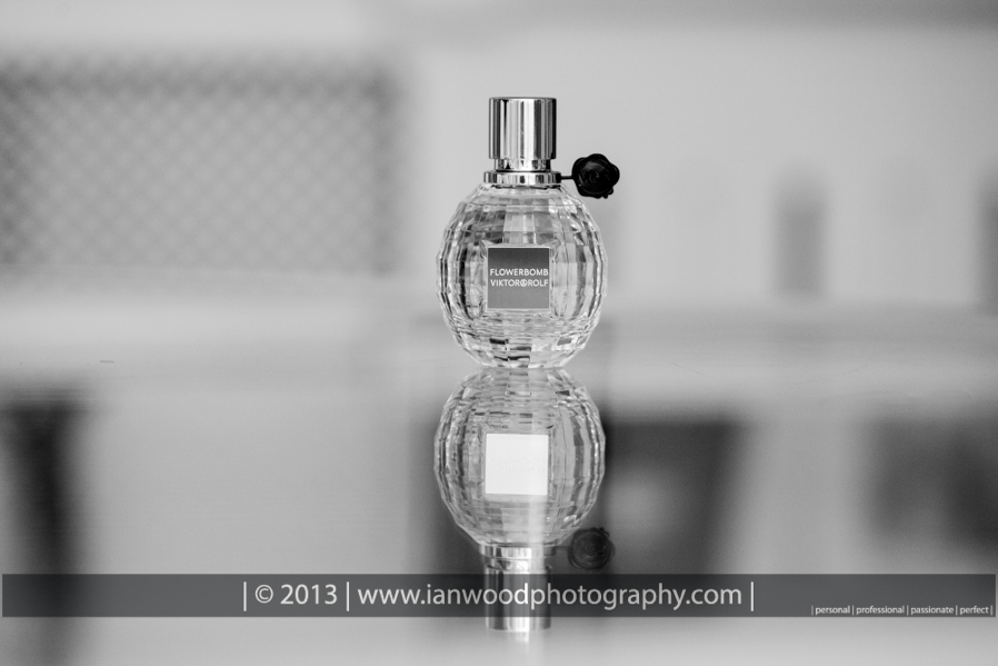 Black and White photograph of the brides perfume bottle.
