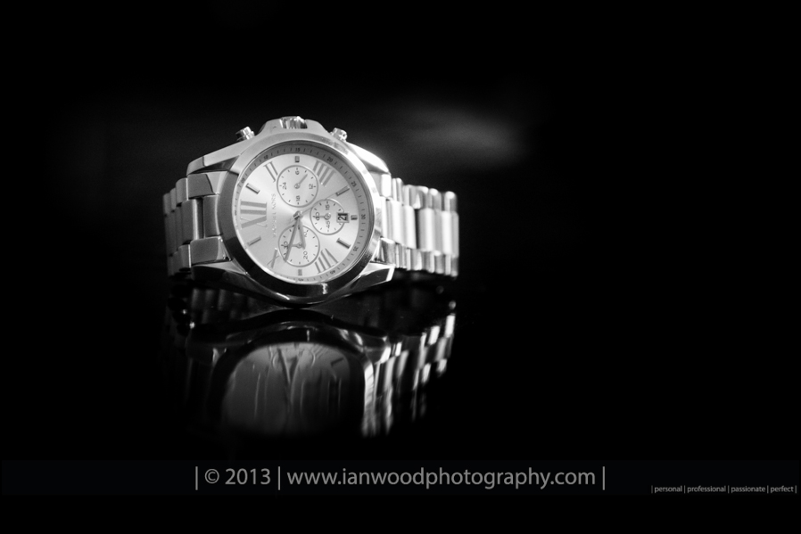 Black and white photograph of a watch that was given to the bride by her groom.