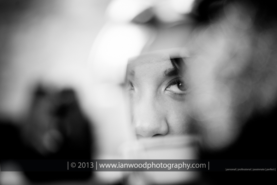 A black and White photograph of a bride having make up applied before her Bartle Hall wedding.