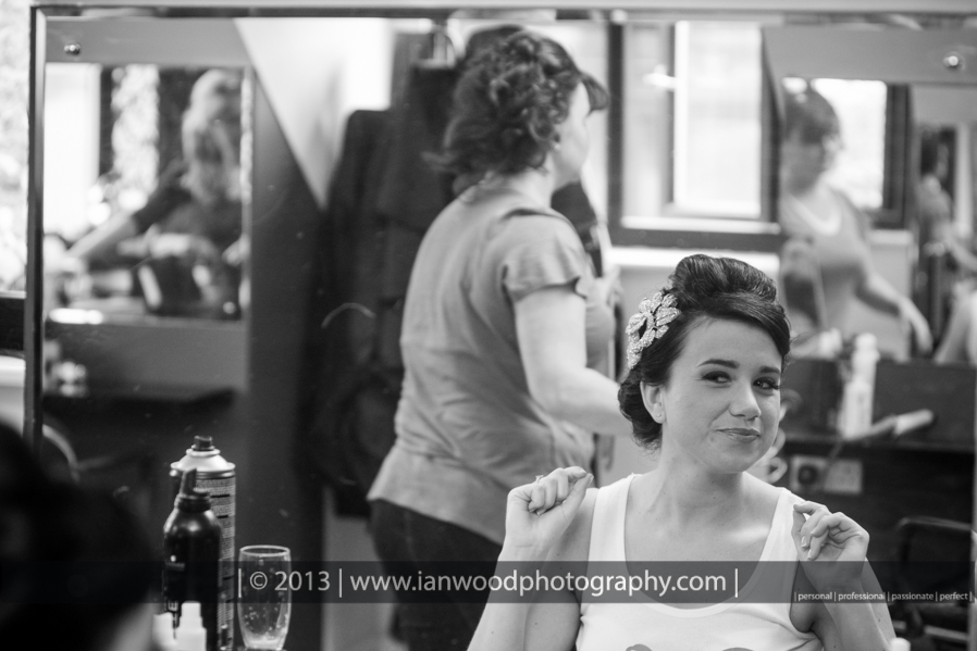 Black and white photograph of bride having just had her wedding hair completed.