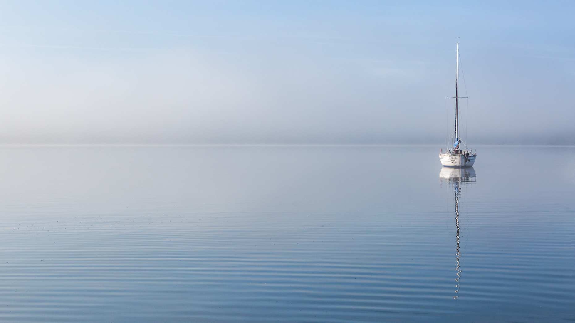 Boat in the lifting mist, Lake Windermere.